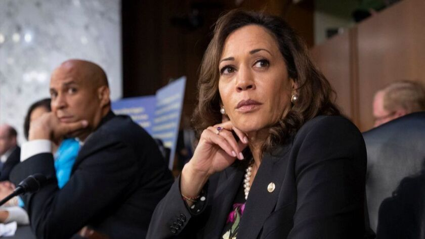 Democratic Sens. Cory Booker of New Jersey, left, and Kamala Harris of California.