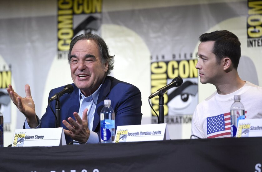"""Director/writer Oliver Stone, left, and Joseph Gordon-Levitt attend the """"Snowden"""" panel on day 1 of Comic-Con International on Thursday, July 21, 2016, in San Diego. (Photo by Chris Pizzello/Invision/AP)"""