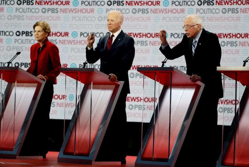 Elizabeth Warren, Joe Biden and Bernie Sanders on the debate stage
