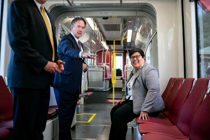 Paul Jablonski, the CEO of San Diego's Metropolitan Transit System and Georgette Gómez, San Diego City Council president and MTS board chairwoman, show off new trolley cars, the Siemens S700 light rail vehicle, at a press conference on Wednesday.