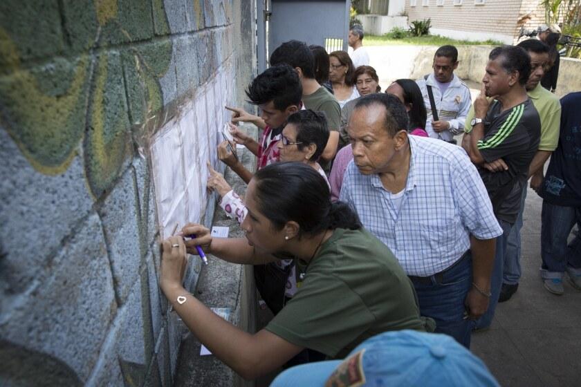 Venezuelans line up to vote in Caracas on Sunday.