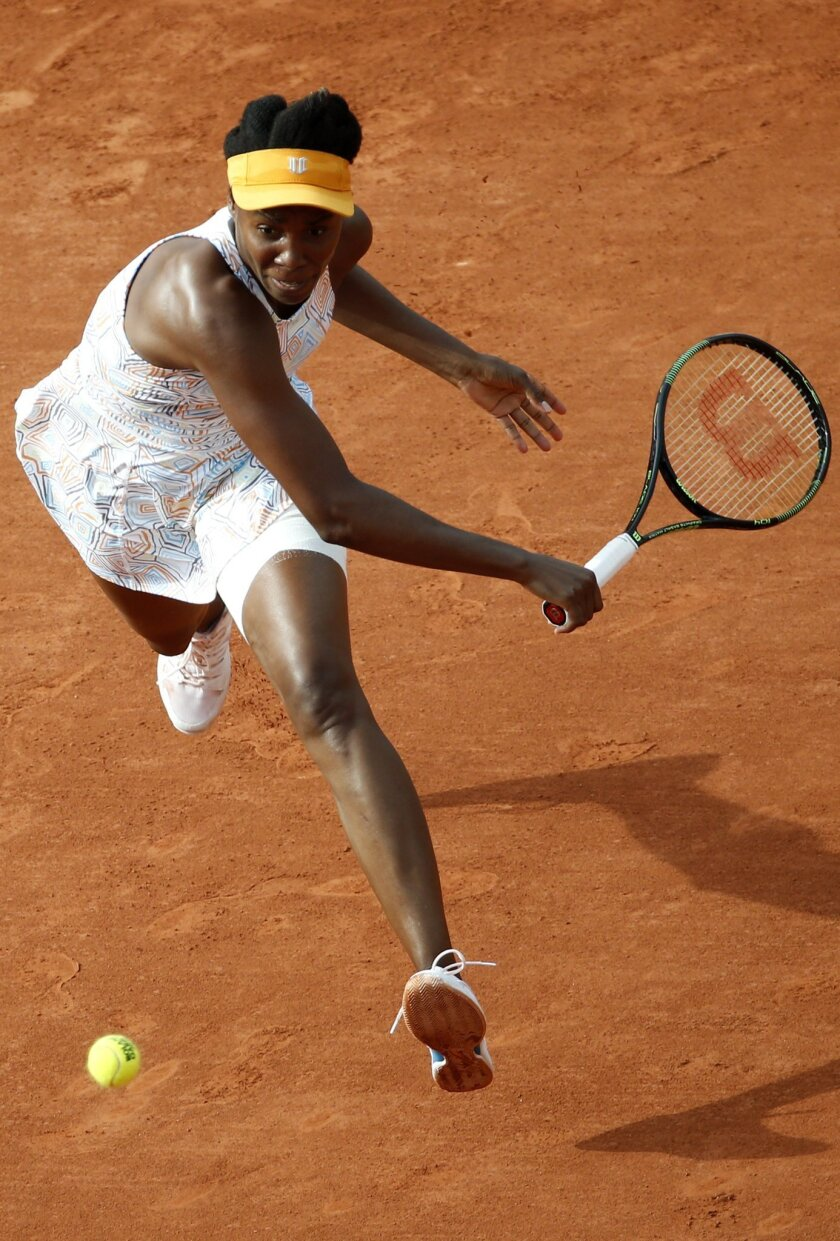 Venus Williams of the U.S. is to return the ball to France's Alize Cornet during their third round match of the French Open tennis tournament at the Roland Garros stadium, Saturday, May 28, 2016 in Paris. (AP Photo/Alastair Grant)