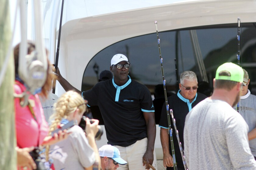 Michael Jordan stands on his boat Catch 23, which brought in a 442.3-pound marlin, Tuesday, June 9, 2020, during the second day of the Big Rock Blue Marlin Tournament in Morehead City, N.C. (Chris Miller/The Daily News via AP)