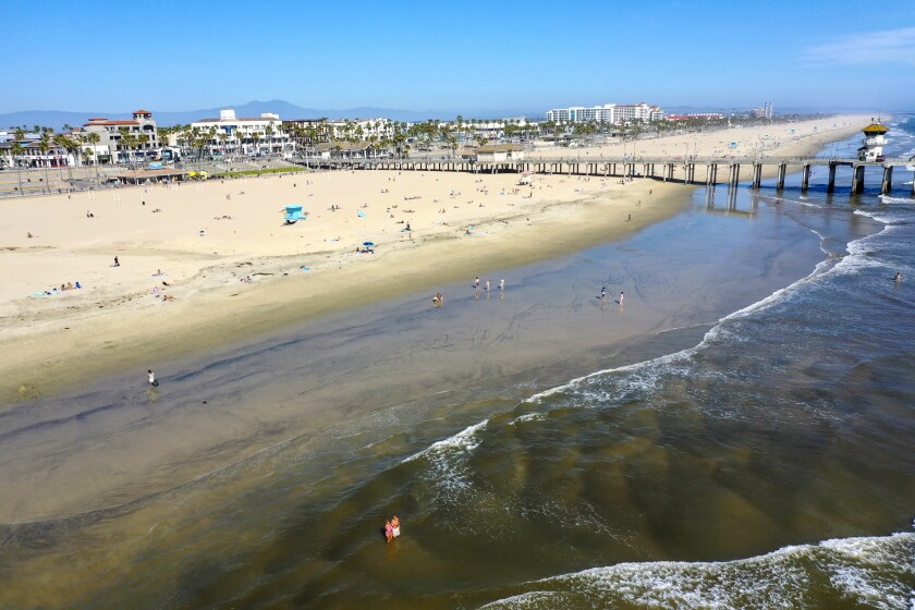 An aerial view shows the closed Huntington Beach pier, in Orange County, on April 22.