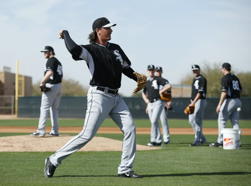 FILE - In this Saturday, Feb. 21, 2015, file photo, Chicago White Sox's Jeff Samardzija throws during a spring training baseball workout in Phoenix. This time last year, the White Sox welcomed the start of spring training with visions of a playoff run after a busy offseason they thought would vault