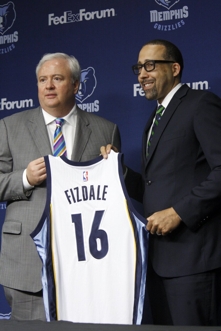 David Fizdale speaks at a news conference where he is introduced as the new head coach of the Memphis Grizzlies NBA basketball team, Tuesday, May 31, 2016, in Memphis, Tenn. Fizdale was previously the assistant head coach of the Miami Heat. At left, General Manager Chris Wallace. (AP Photo/Karen Pu