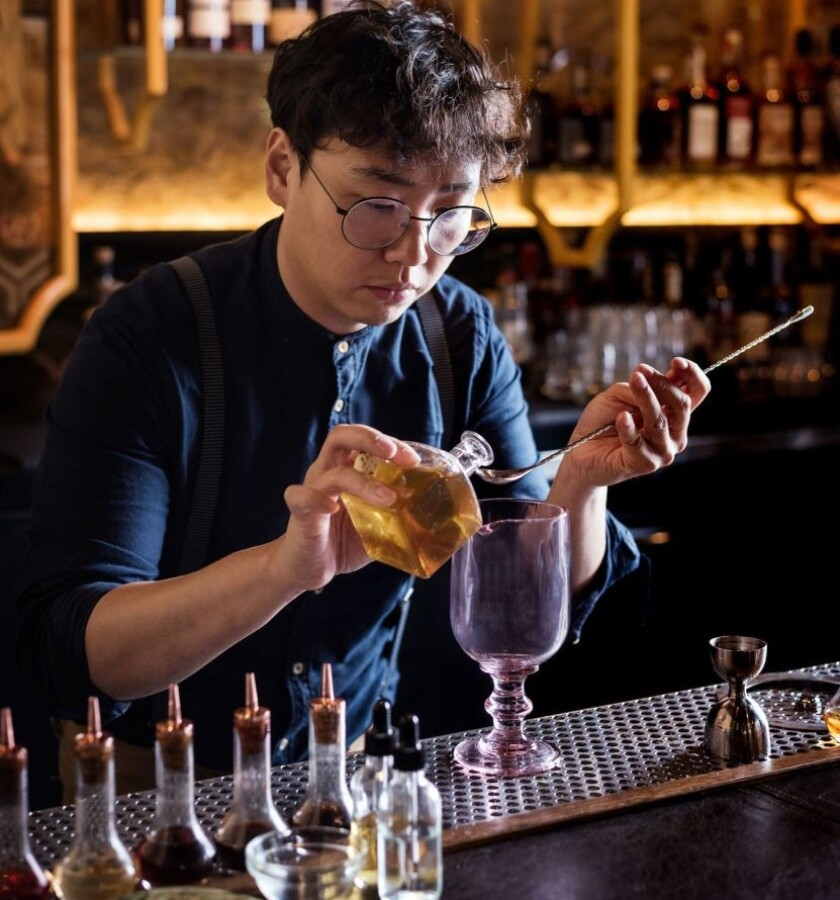 Realm of the 52 Remedies bartender Chris Lee is like a mad scientist, combining high-end spirits with homemade potions to create the innovative cocktails at the Convoy Street speakeasy. Many of Lee's flavor profiles are inspired by his upbringing in Korea.
