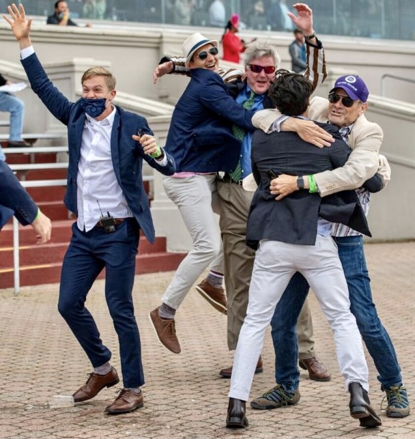 Co-owners of Hot Rod Charlie, including Del Mar's Bill Strauss, right, celebrate winning the recent Louisiana Derby