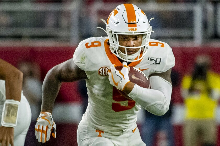 FILE - In this Oct. 19, 2019, file photo,Tennessee running back Tim Jordan (9) carries the ball during the first half of an NCAA college football game against Alabama in Tuscaloosa, Ala. Tennessee coach Jeremy Pruitt says running back Tim Jordan is no longer on the team after he was arrested May 30 in Florida on gun and marijuana charges. (AP Photo/Vasha Hunt, File)