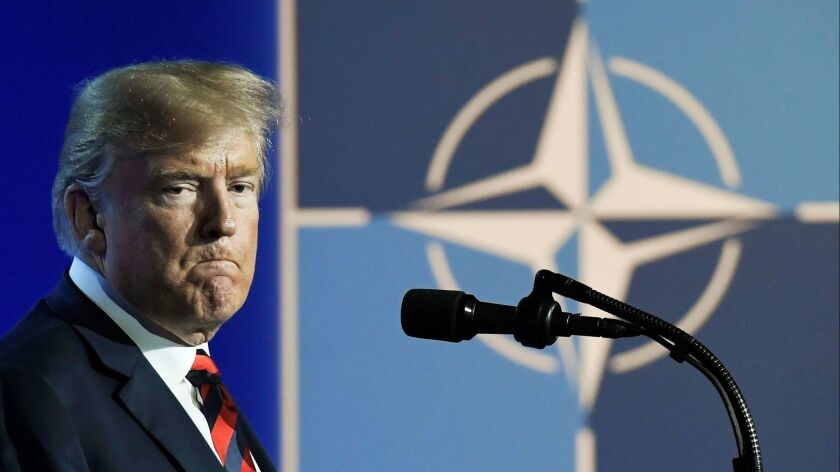 President Trump speaks at a news conference at the NATO summit in Belgium on July 12.