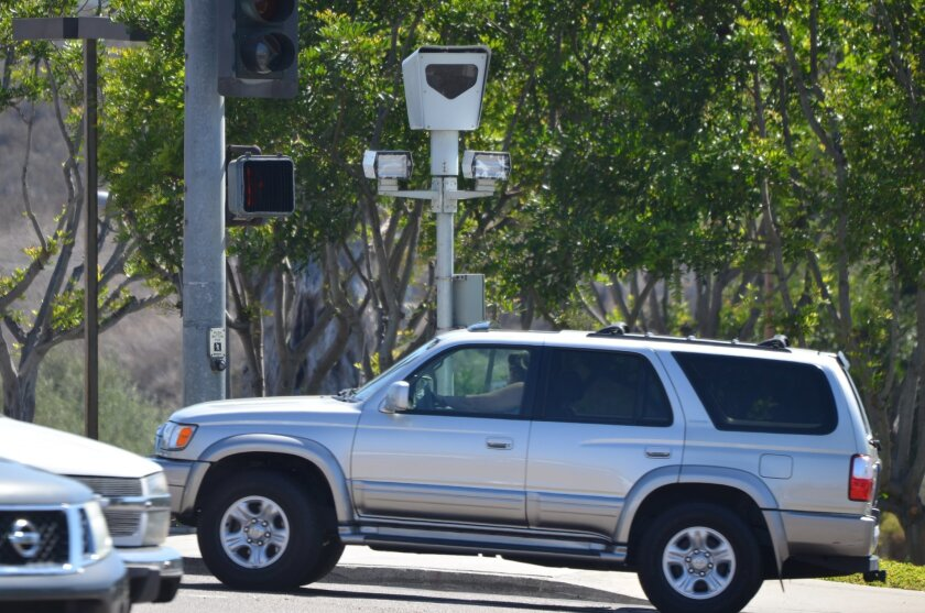 Red light camera at the busy intersection of El Camino Real and Vista Way in Oceanside.