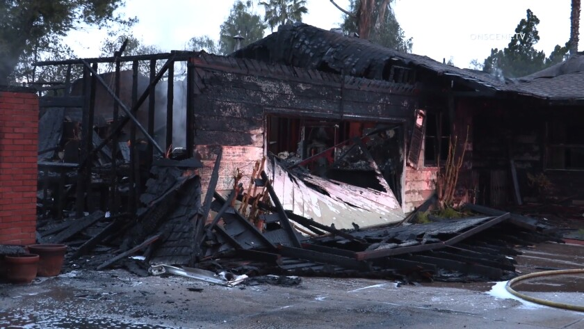 Two firefighters in El Cajon were injured when a portion of a burning building collapsed on them early Tuesday.