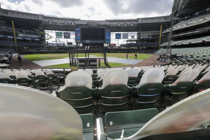 Fan cutouts are seen behind home plate at Miller Park on Friday in Milwaukee.