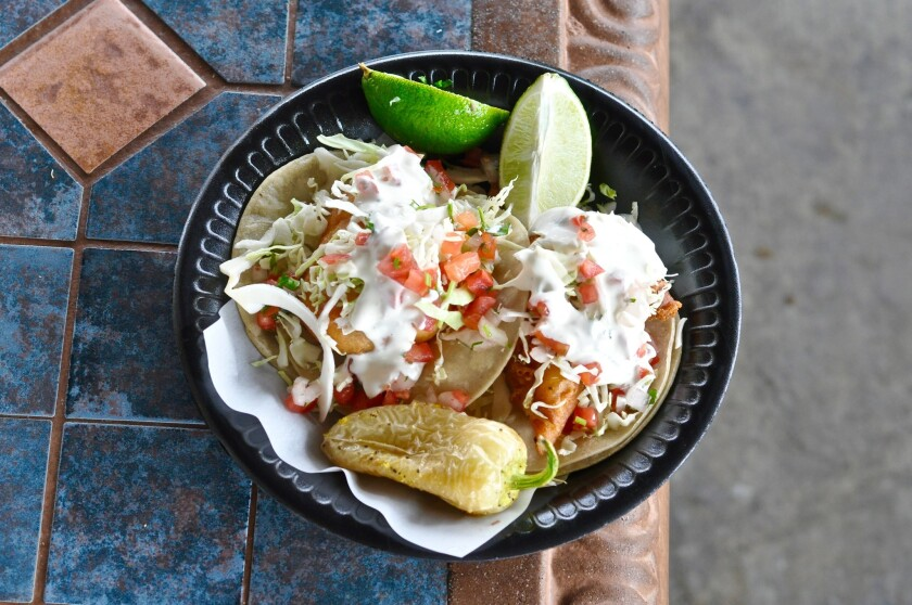 Love fish tacos? Head to La Puente, where the original Taco Nazo, whose fish tacos are pictured here, and Colonia Taco Lounge are right next door.