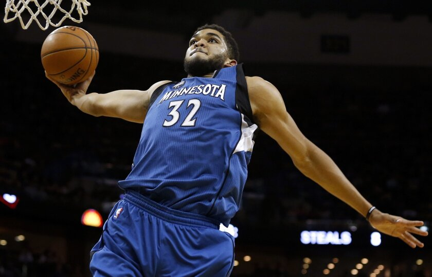 Minnesota Timberwolves center Karl-Anthony Towns (32) dunks during the second half of an NBA basketball game against the New Orleans Pelicans, Saturday, Feb. 27, 2016, in New Orleans. The Timberwolves won 112-110. (AP Photo/Jonathan Bachman)