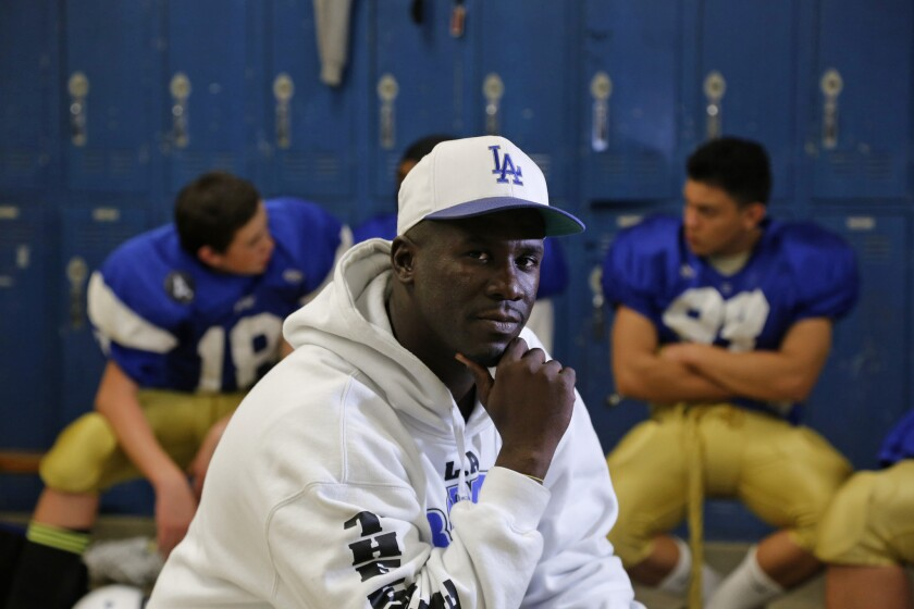 Los Angeles Romans Coach Eric Scott is pictured in the locker room before a practice on Dec. 3. Scott, a former UCLA assistant, took over a 1-9 team and now the Romans are playing for the City Division III championship.