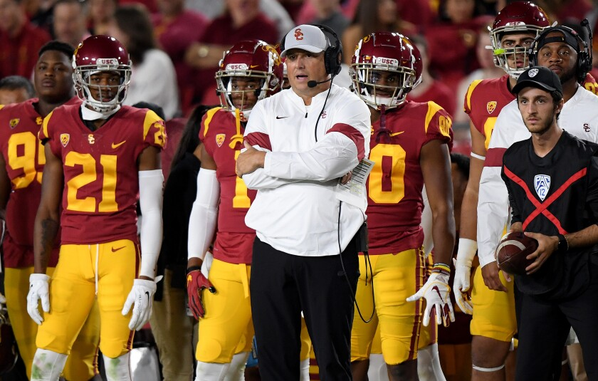 USC coach Clay Helton watches play from the sidelines during the first half against Arizona at the Coliseum on Oct. 19.