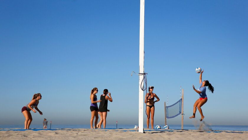 The 692 Beach Volleyball Club practices during the offseason at South Mission Beach. Sand volleyball, played in the spring, is trying to become a CIF sport.