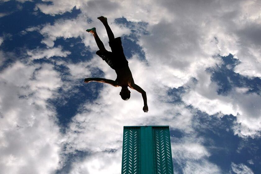 A child dives into the pool at the Bobby Bonds Community Center in Riverside.