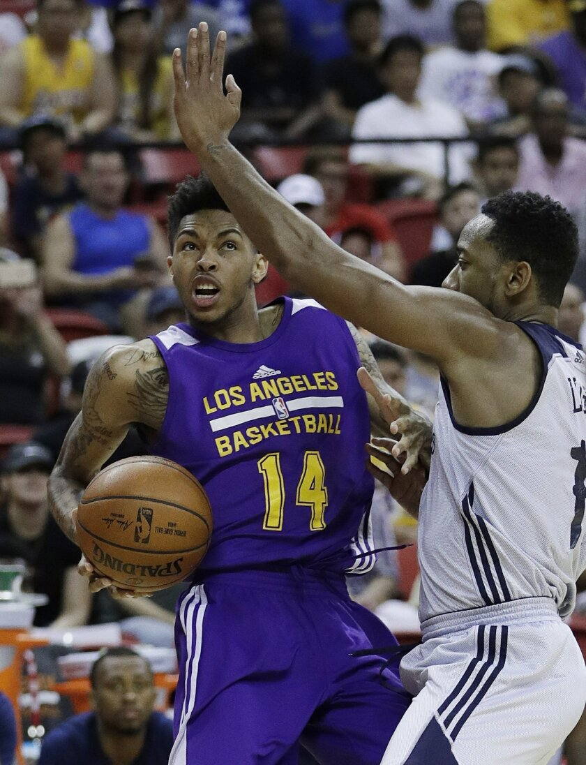Los Angeles Lakers' Brandon Ingram drives around New Orleans' David Lighty Jr. during the second half of an NBA summer league basketball game, Friday, July 8, 2016, in Las Vegas. (AP Photo/John Locher)