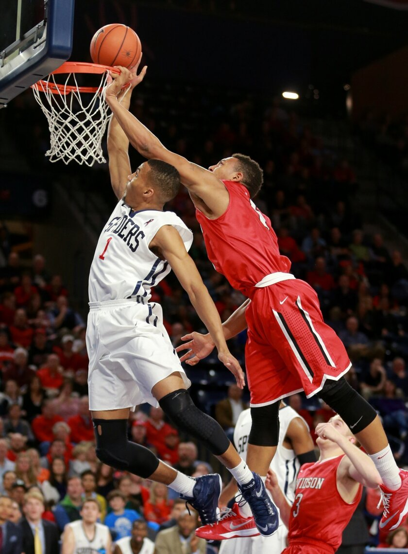 Richmond's Josh Jones, left, is fouled by  Davidson's Jordan Barham (5) during the second half of an NCAA college basketball game Saturday, Jan. 17, 2015, in Richmond, Va. Richmond won 89-63. (AP Photo/Richmond Times-Dispatch, Daniel Sangjjib Min)