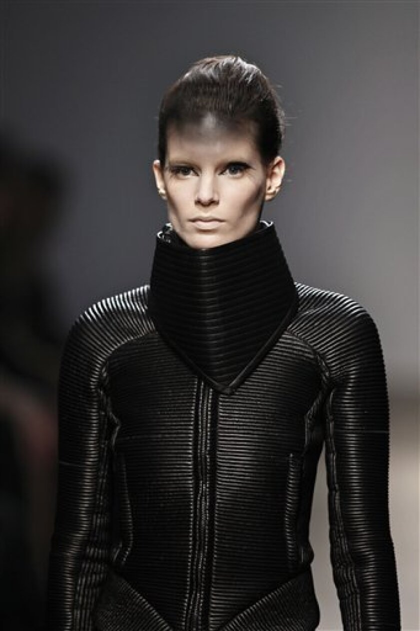 A model wears a creation by British fashion designer Gareth Pugh as part of his Fall-Winter 2010-2011 ready-to-wear fashion collection presented in Paris, Wednesday March 3, 2010. (AP Photo/Thibault Camus)