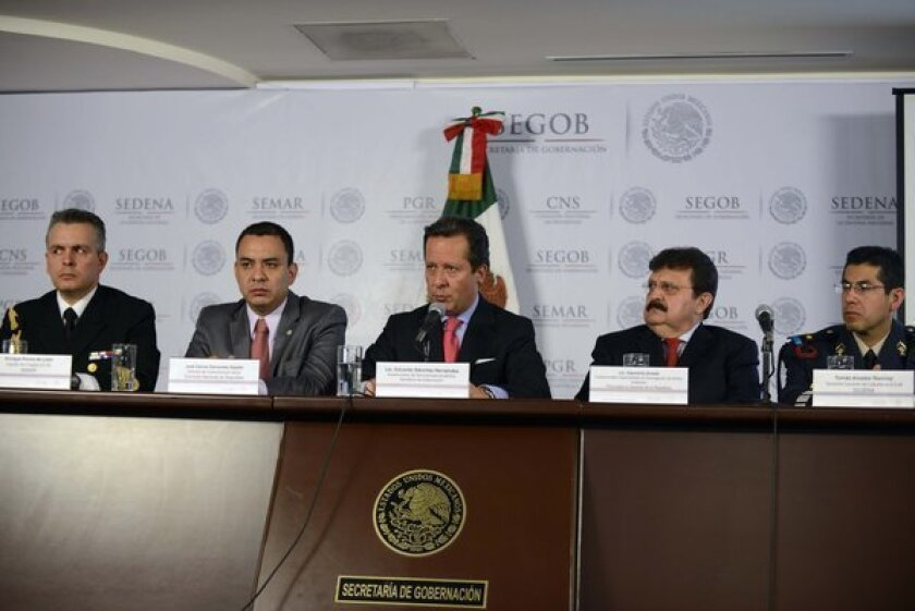"""From left to right, Mexican Navy Capt. Enrique Ponce de Leon, National Commission of Security media director Carlos Cervantes, the under-secretary of media for the Interior Ministry, Eduardo Sanchez, the under-attorney for organized crime, Cleominio Soreda, and Mexican Army Lt. Col. Tomas Amador, attend a press conference Tuesday in Mexico City on the capture of Ines Coronel Barrera, father-in-law and associate of drug kingpin Joaquin """"Chapo"""" Guzman."""
