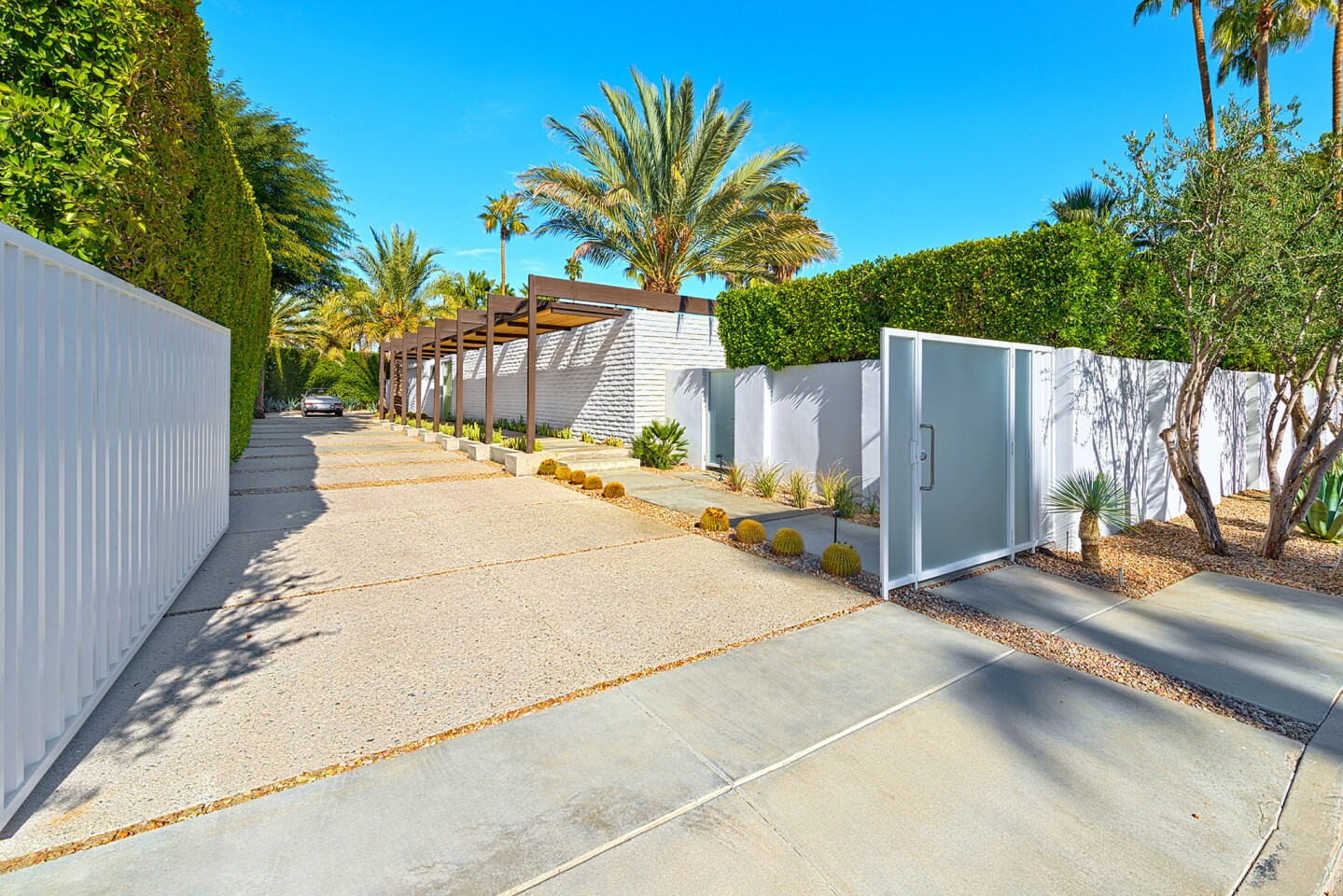The third-of-an-acre property is walled and gated. Tall hedges provide further privacy.