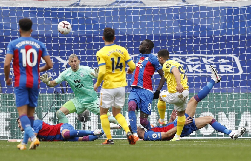 Brighton's Neal Maupay, right gets his shot deflected over the bar during an English Premier League soccer match between Crystal Palace and Brighton at the Selhurst Park stadium in London, England, Sunday Oct. 18, 2020. (Adrian Dennis/Pool via AP)