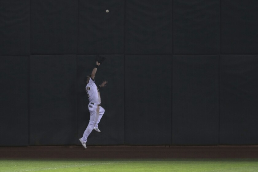 Oakland Athletics' Robbie Grossman catches a ball hit by Seattle Mariners' Joseph Odom during the eighth inning of a baseball game in Oakland, Calif., Friday, Sept. 25, 2020. (AP Photo/Jed Jacobsohn)