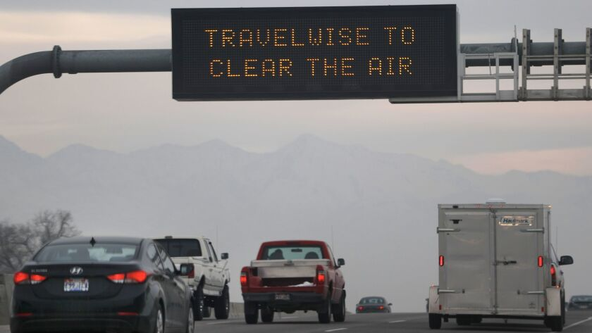 Thick smog caused by a temperature inversion looms on Interstate 15 near Salt Lake City.