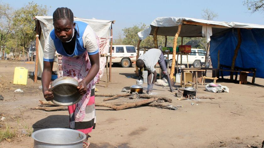 A South Sudanese refugee cooks food at a restaurant in a refugee camp in Bidi bidi, Uganda, on Dec. 13.