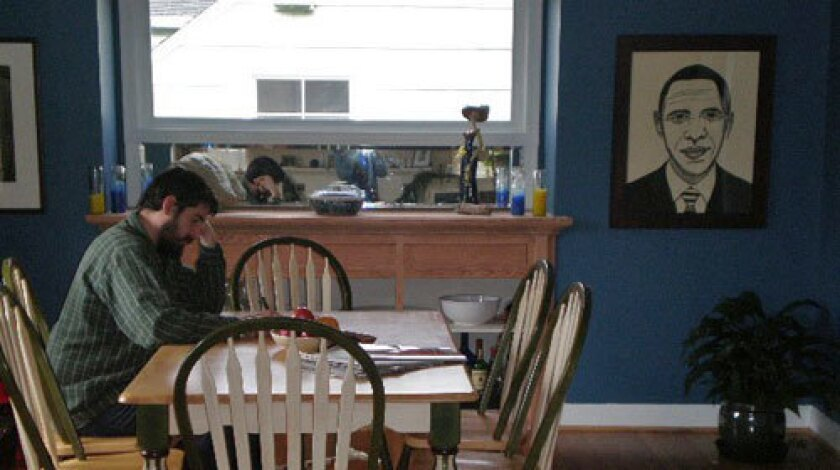 A lino cut of Barack Obama by Valerie Wallace hangs in Guillermo Maciel's dining room.