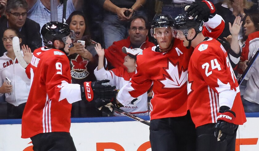 Team Canada's Matt Duchene (9), Jonathan Toews (16) and Corey Perry (24) celebrate Toews' goal during the first period against Team Europe during the World Cup of Hockey on Sept. 21.
