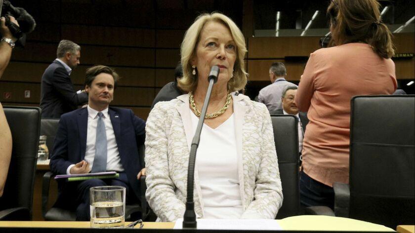 U.S. Ambassador Jackie Wolcott waits for the start of the International Atomic Energy Agency, IAEA,
