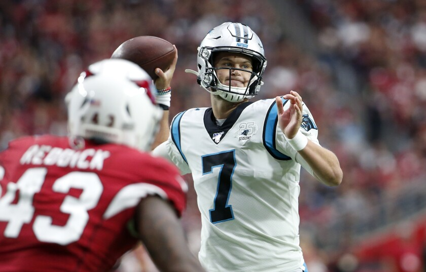 Panthers quarterback Kyle Allen throws a touchdown pass to Greg Olsen during the first half against the Arizona Cardinals on Sunday.