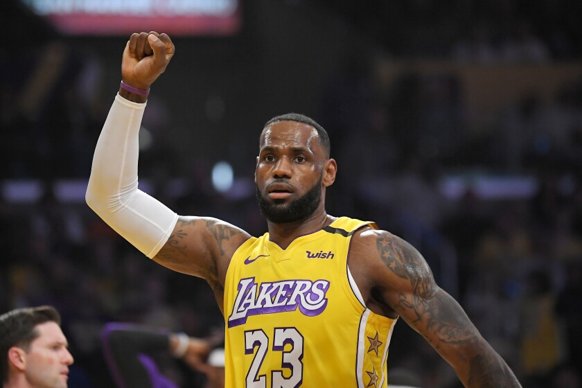 Los Angeles Lakers forward LeBron James celebrates after scoring during the first half of the team's NBA basketball game against the New Orleans Pelicans on Friday, Jan. 3, 2020, in Los Angeles. (AP Photo/Mark J. Terrill)
