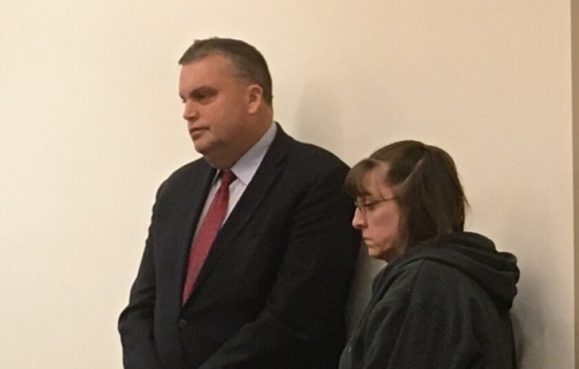 Shelly Hueckel, right, appears in court Tuesday, Feb. 11, 2020 in Grand Rapids, Mich. for sentencing on an assault and battery charge. Heuckel, who used racial slurs as she attacked a black car salesman at a western Michigan dealership, avoided a jail sentence despite a tearful appeal from the victim for time behind bars. She was sentenced Tuesday to two years of probation by Judge Paul Sullivan. ( John Tunison/The Grand Rapids Press via AP)
