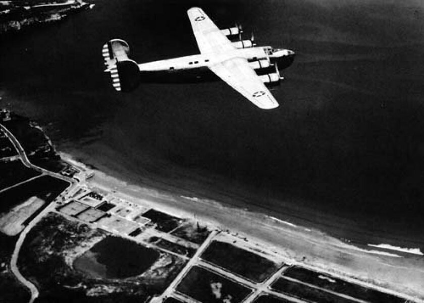 A Consolidated B-24 Liberator flies over La Jolla Shores during WWII. Courtesy: Jim McKellar