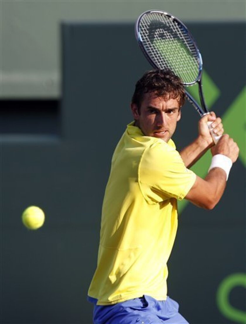 Marin Cilic of Croatia eyes the ball during his match against Juan Martin Del Potro of Argentina at the Sony Ericsson Open tennis tournament, Monday, March 26, 2012, in Key Biscayne, Fla. (AP Photo/Lynne Sladky)