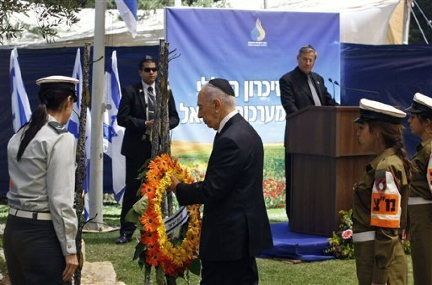 Israel's President Shimon Peres lays a wreath during the annual Memorial Day ceremony commemorating fallen soldiers, at the Mt. Herzl military cemetery in Jerusalem, Monday, May 9, 2011. Israel marked its Memorial Day for fallen soldiers and victims of militant attacks Monday, with ceremonies and a