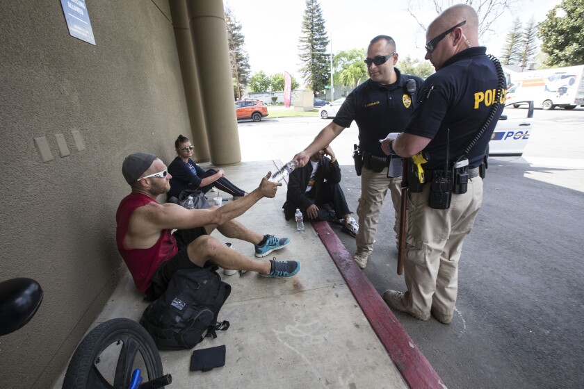 Bakersfield police officers hand out pamphlets