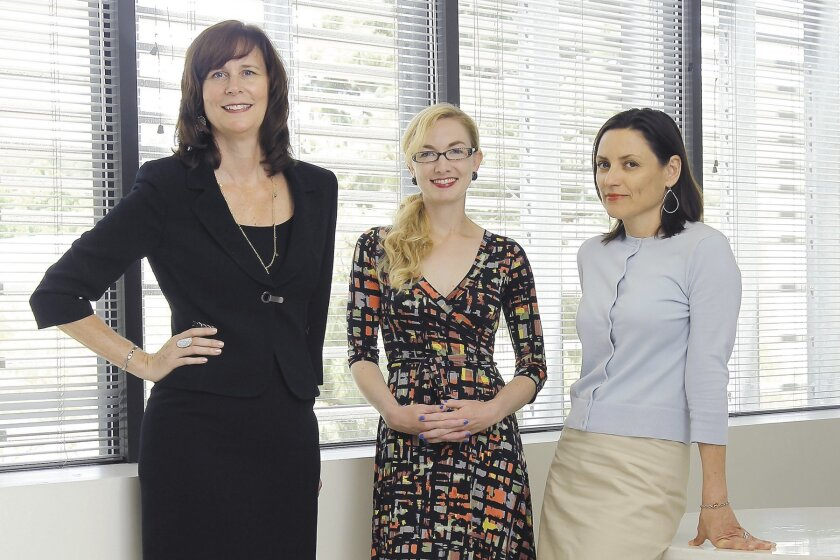 ArtPower's Kathryn Martin (from left), Molly Clark and Rebecca Webb in the ArtPower offices at UC San Diego.