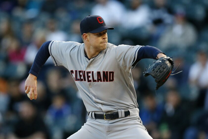 Cleveland Indians starting pitcher Corey Kluber delivers against the Chicago White Sox during the first inning of a baseball game Monday, May 18, 2015, in Chicago. (AP Photo/Andrew A. Nelles)