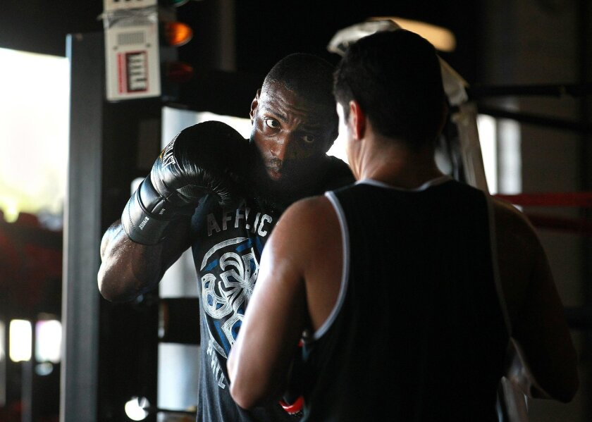 World No. 6 light heavyweight contender Phil Davis, shown with head coach Eric Del Fierro at Alliance gym in Chula Vista. Davis will fight Glover Texeira in the co-main event of UFC 179 on Oct. 25.