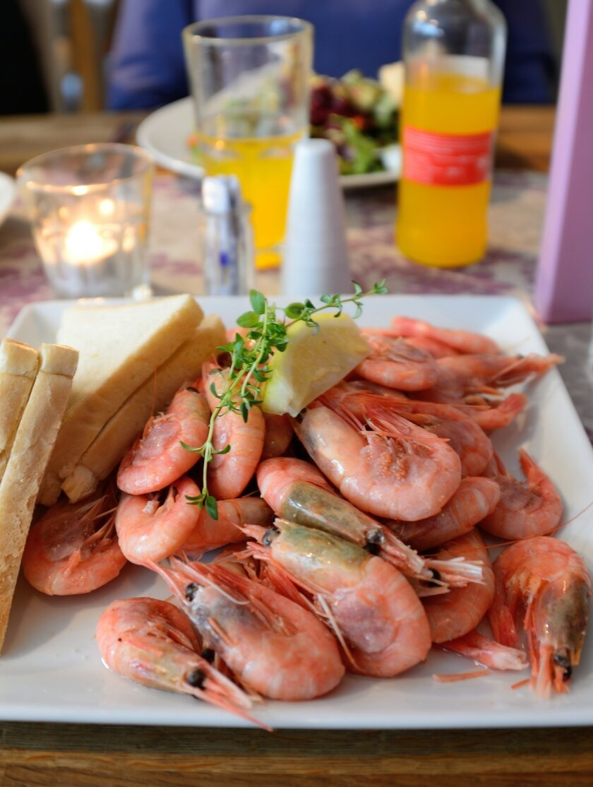 Piles of fresh shrimp boiled in garlic and butter are served with white bread and mayonnaise at Lyst, a locals' favorite restaurant in Alesund.