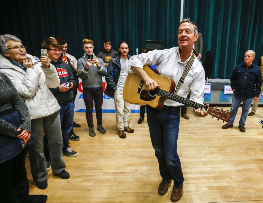 Democratic presidential candidate Martin O'Malley plays a guitar and sings after a campaign event in Grinnell, Iowa, on Wednesday.