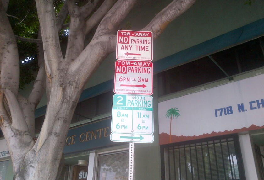 Confusing parking signs seen on Cherokee Avenue north of Hollywood Boulevard in 2013.