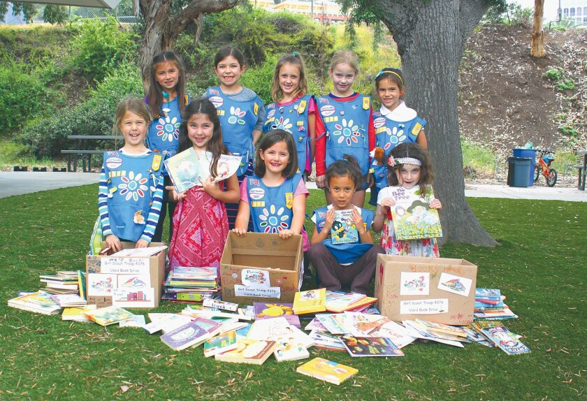 Front Row: Clara Siddons, Sofia Costello, Leyla Yazici, Emery Hom and Ella Cathalinat. Back Row: Sienna Miller, Gaia Campos, Lily Schroeder, Stella Newcomer and Siena Pellicano with some of the books they collected for their book drive. The literary treasures will go to an underserved school in the