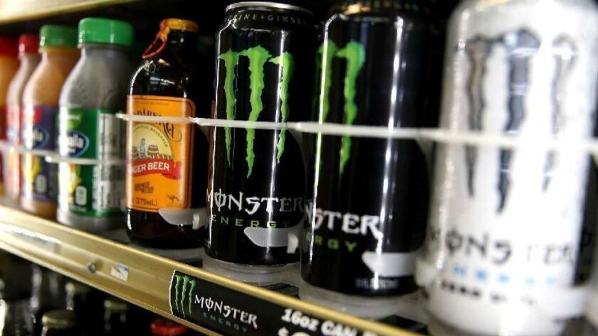 Cans of Monster Energy drink are displayed on a shelf at a convenience store. A Riverside County jury this week found that the company was not liable for a Texas man's heart attack.